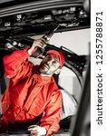 handsome auto service worker in ... | Shutterstock . vector #1255788871