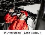 handsome auto service worker in ... | Shutterstock . vector #1255788874