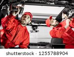 two auto service workers in red ... | Shutterstock . vector #1255788904