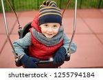 cute little boy having fun on... | Shutterstock . vector #1255794184
