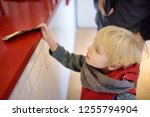 little boypay off currency note.... | Shutterstock . vector #1255794904