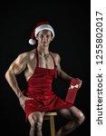 athlete muscular man wear santa ...   Shutterstock . vector #1255802017