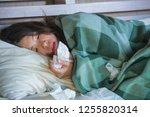 young sick sweet asian american ... | Shutterstock . vector #1255820314