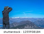 tourist with a hat taking... | Shutterstock . vector #1255938184
