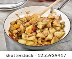 gourmet sauteed potato wedges... | Shutterstock . vector #1255939417