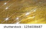 background of golden shining...   Shutterstock . vector #1256038687