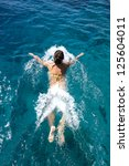 woman swims in the sea | Shutterstock . vector #125604011