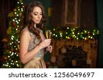woman at christmas | Shutterstock . vector #1256049697