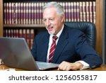 businessman using his laptop in ... | Shutterstock . vector #1256055817
