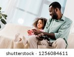 african american dad and... | Shutterstock . vector #1256084611