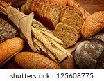 Fresh Bread  And Wheat On The...