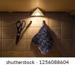 scissors and a pot holder...   Shutterstock . vector #1256088604