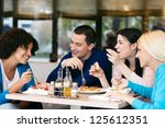 four cheerful friends chatting... | Shutterstock . vector #125612351