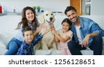 portrait of happy family with a ... | Shutterstock . vector #1256128651