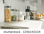 white kitchen with dishware ... | Shutterstock . vector #1256142124