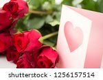 Stock photo love valentines day and holidays concept close up of red roses bunch and greeting card with heart 1256157514