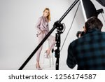 cropped shot of photographer... | Shutterstock . vector #1256174587