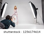 young photographer with camera... | Shutterstock . vector #1256174614