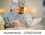 senior couple relaxing at home ... | Shutterstock . vector #1256210104
