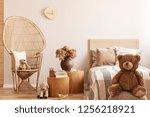 teddy bear sitting on pouf in... | Shutterstock . vector #1256218921