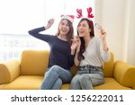 happy friends two young asian... | Shutterstock . vector #1256222011