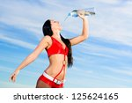 young female sport girl in red... | Shutterstock . vector #125624165