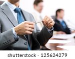 businessman sitting at a table... | Shutterstock . vector #125624279