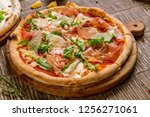 pizza with parma ham and arugula | Shutterstock . vector #1256271061