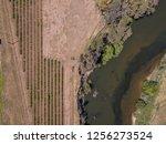 birds eye view of river running ... | Shutterstock . vector #1256273524