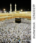 Small photo of MECCA - JULY 21 : A crowd of pilgrims circumabulate (tawaf) Kaaba on July 21, 2012 in Mecca, Saudi Arabia. Pilgrims circumambulate the Kaaba seven times in counterclockwise direction.