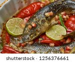 baked grey mullet   middle... | Shutterstock . vector #1256376661
