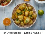batata hara middle eastern... | Shutterstock . vector #1256376667