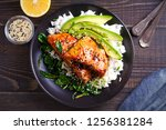 Stock photo salmon in honey soy glaze with rice spinach and avocado overhead horizontal 1256381284