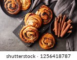 freshly baked sweet buns on... | Shutterstock . vector #1256418787