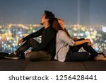 romantic couple sitting on the... | Shutterstock . vector #1256428441