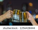 hand holding and clinking with... | Shutterstock . vector #1256428444