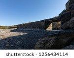 dyke bridge in ruins towards an ...   Shutterstock . vector #1256434114