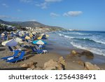 beach with umbrellas and...   Shutterstock . vector #1256438491