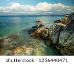 kassiopi beach in corfu island | Shutterstock . vector #1256440471