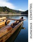 A wooden canoe on Big River in Mendocino, California.