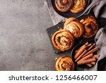 freshly baked sweet buns on... | Shutterstock . vector #1256466007