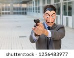 businessman with mask holding a ...   Shutterstock . vector #1256483977