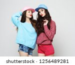 two stylish sexy hipster girls ... | Shutterstock . vector #1256489281