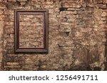 vintage frame on old brick wall   Shutterstock . vector #1256491711