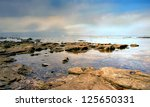 Sunrise At A Rocky Beach In Th...