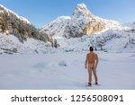 naked adventurous man enjoying... | Shutterstock . vector #1256508091