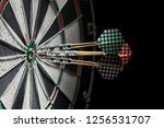 Small photo of three darts in a bull's eye. 150
