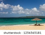 sunbeds and umbrellas on a...   Shutterstock . vector #1256565181