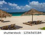 sunbeds and umbrellas on a...   Shutterstock . vector #1256565184