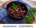 jug of goulash beef stew with... | Shutterstock . vector #1256568931